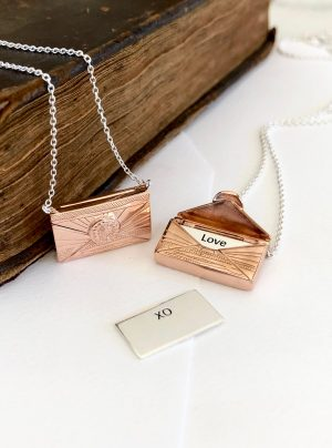 Love letter locket in rose gold when opened reveals a secret letter