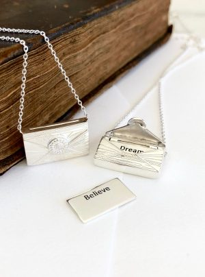 Love letter locket in silver when opened reveals a secret letter