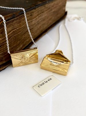Love letter locket in yellow gold when opened reveals a secret letter