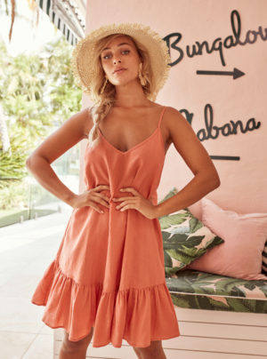 Frill dress in melon