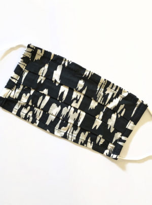 black mask with abstract pattern