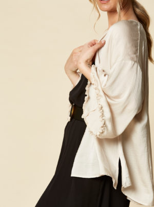 cape with frill sleeves in cream
