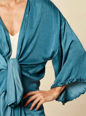 cape in teal with frill sleeves