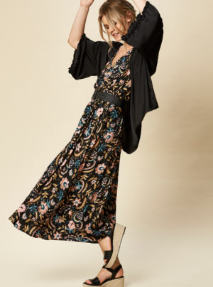 Black cape with frill sleeves