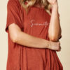 t-shirt with metallic senorita across the front in clay colour