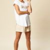 white t-shirt with metallic brush print across the front