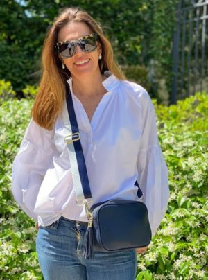 navy bag with navy and white fabric strap
