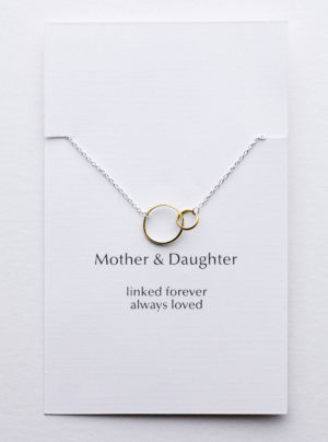 yellow gold linked circles on a sterling silver chain