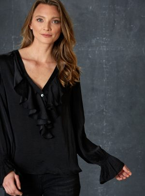 black silky soft blouse with ruffle neckline