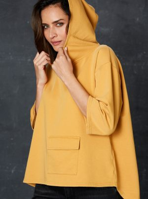 saffron coloured hoodie with large pocket at the front