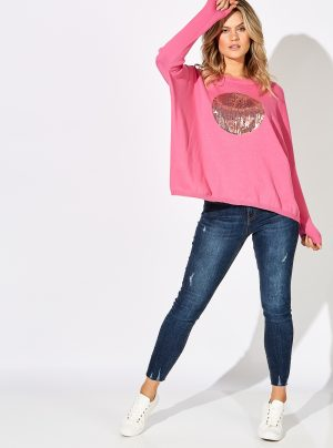 hot pink knit with large sequin circle