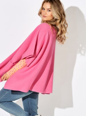 Loose fitting cape in hot pink