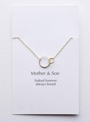 Yellow gold necklace with 2 linked circles on a card that says linked forever always loved