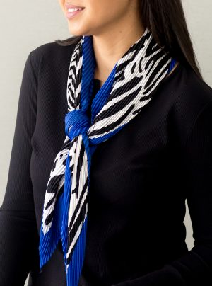 model wearing a pleated scarf with animal print and a blue border