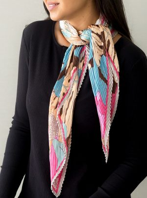 Model wearing a bright coloured botanical print scarf