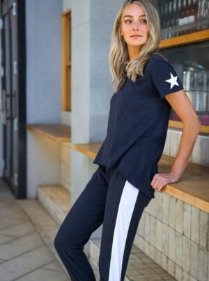 navy t-shirt with white stars on each sleeve