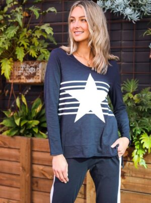 Navy long sleeve top with white stripes across the front and a large star