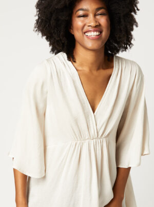 summer top in silky material in off white colour