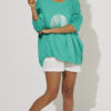 Green coloured knit with silver rainbow foil motif